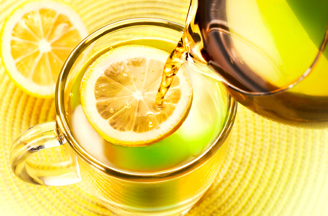 pouring_water_into_pitcher_with_lemon